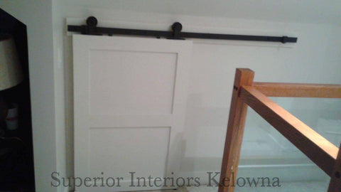Custom built solid wood interior barn style doors by Superior Interiors Kelowna