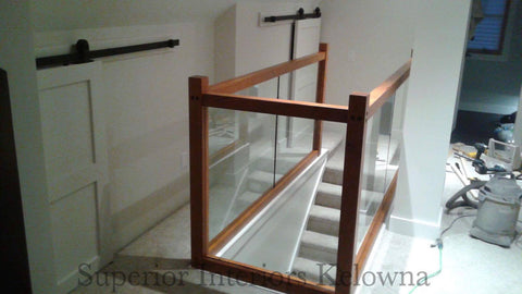 Custom built solid wood and glass railings by Superior Interiors Kelowna