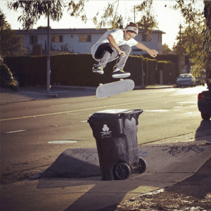 Elliot Murphy switch flip over a garbage can.
