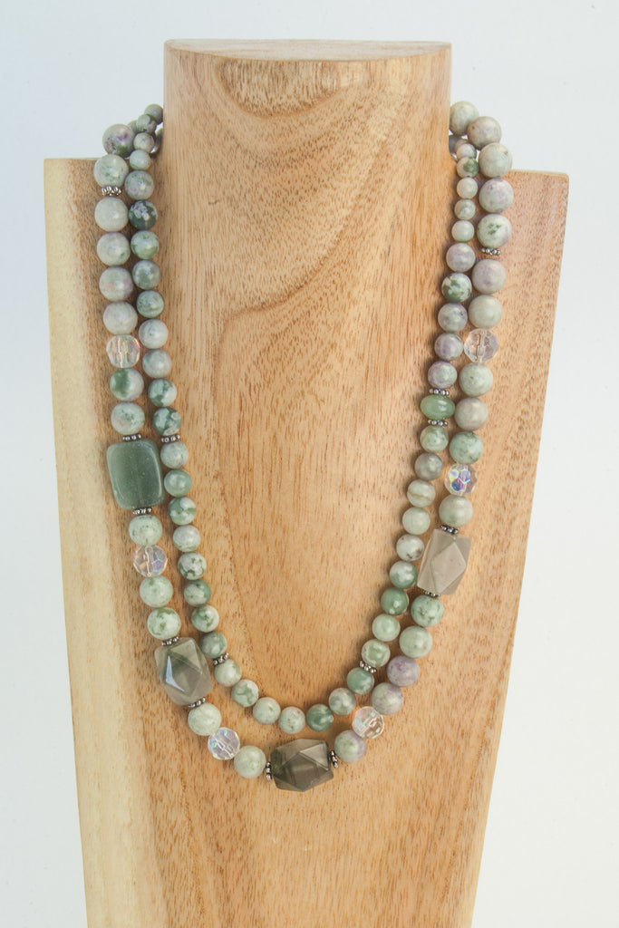 Pale green Howlite, clear Crystal, sterling clasp.