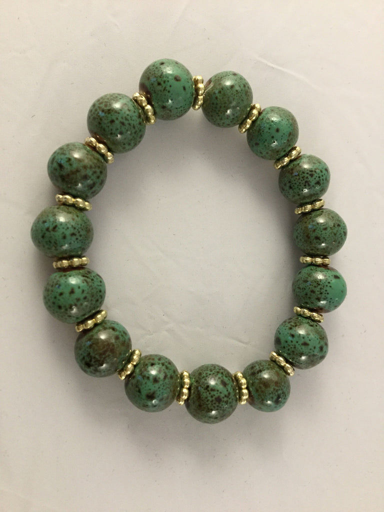BG1S has 10mm green ceramic balls with gold tone star inserts. It is $30.