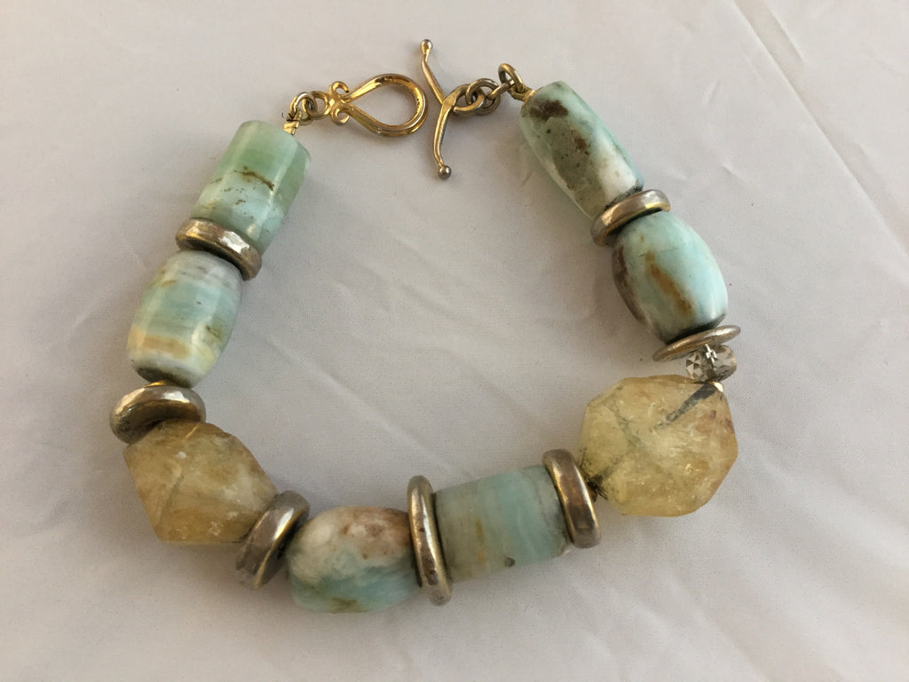 BG7S  has tubular and oval chalcedony, citrine nuggets  with gold filled inserts and toggle clasp. $85.00