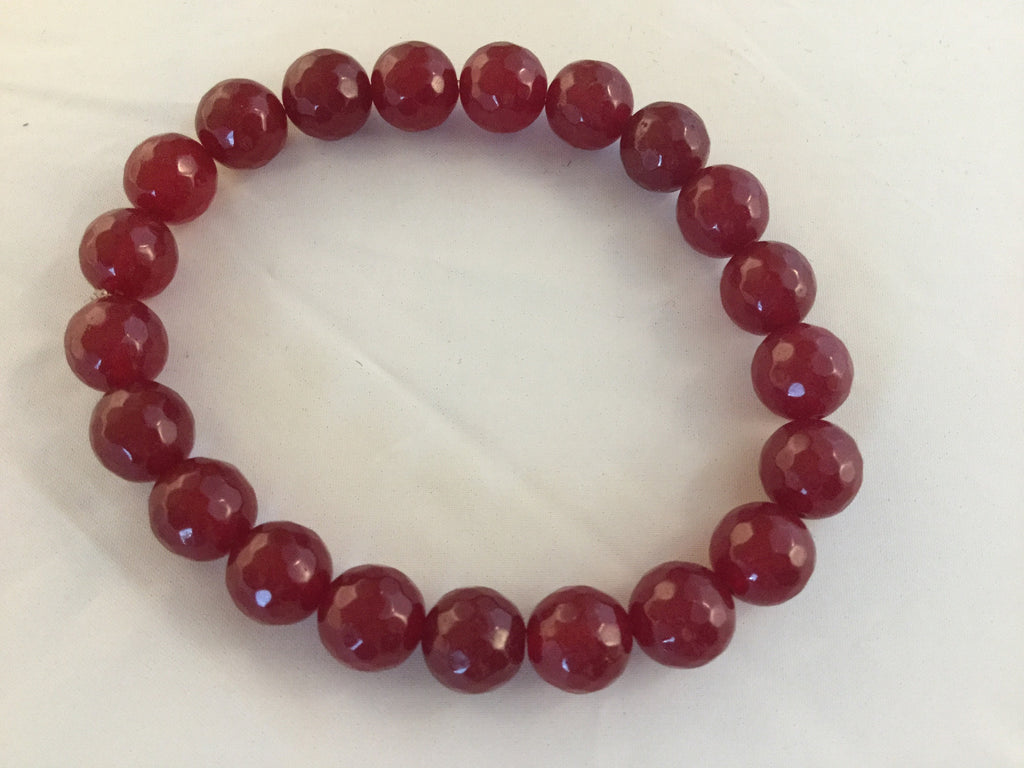 BR1S is a stretch bracelet with 8mm faceted red Rubies.