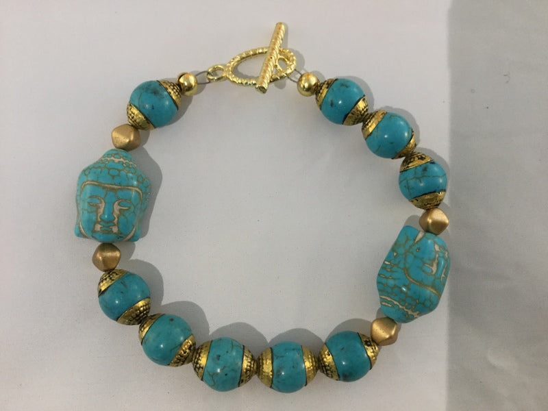 BT21: Turquoise and bronze bracelet with 2 carved Buddhas and gold metal toggle