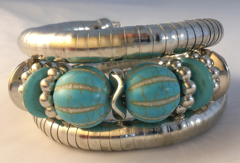 BT22: Tibetan fun simulated silver wrap bracelet.