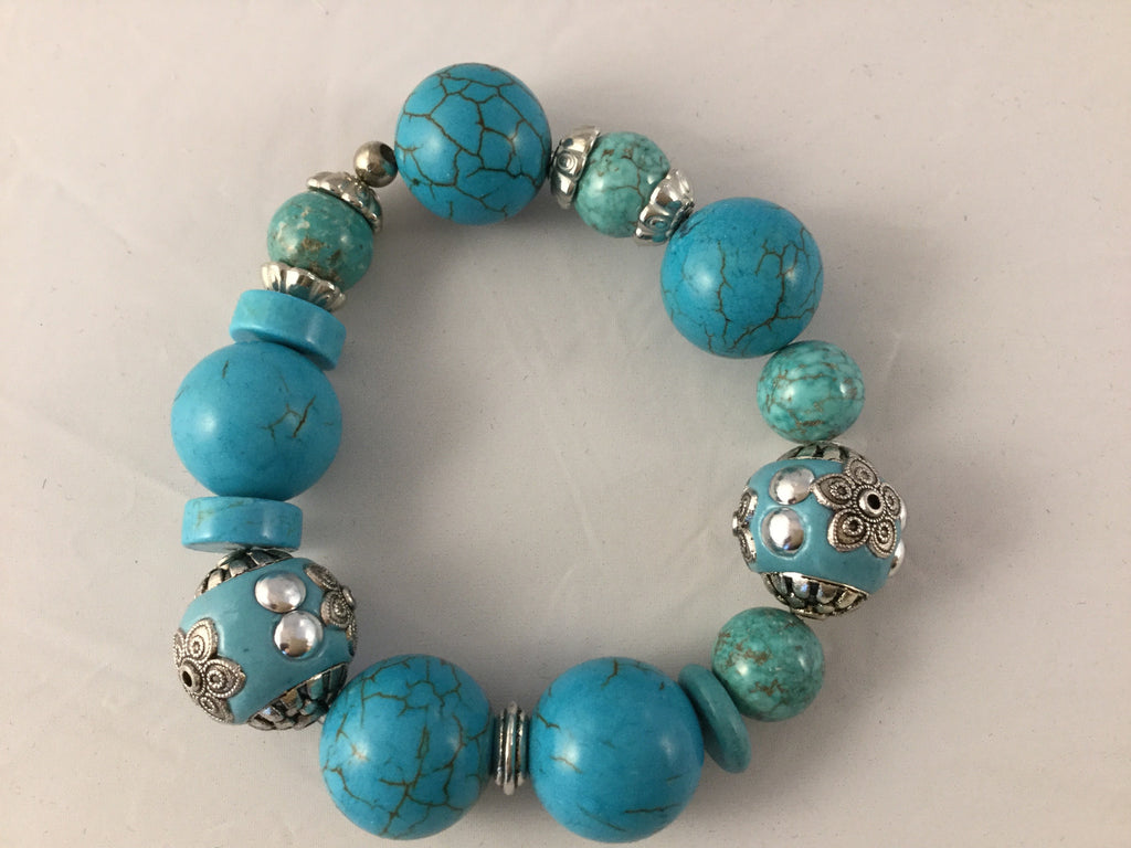BT2S is a fancy stretch turquoise and Turq/Howlite Bracelet that will spice up your silver bangles.