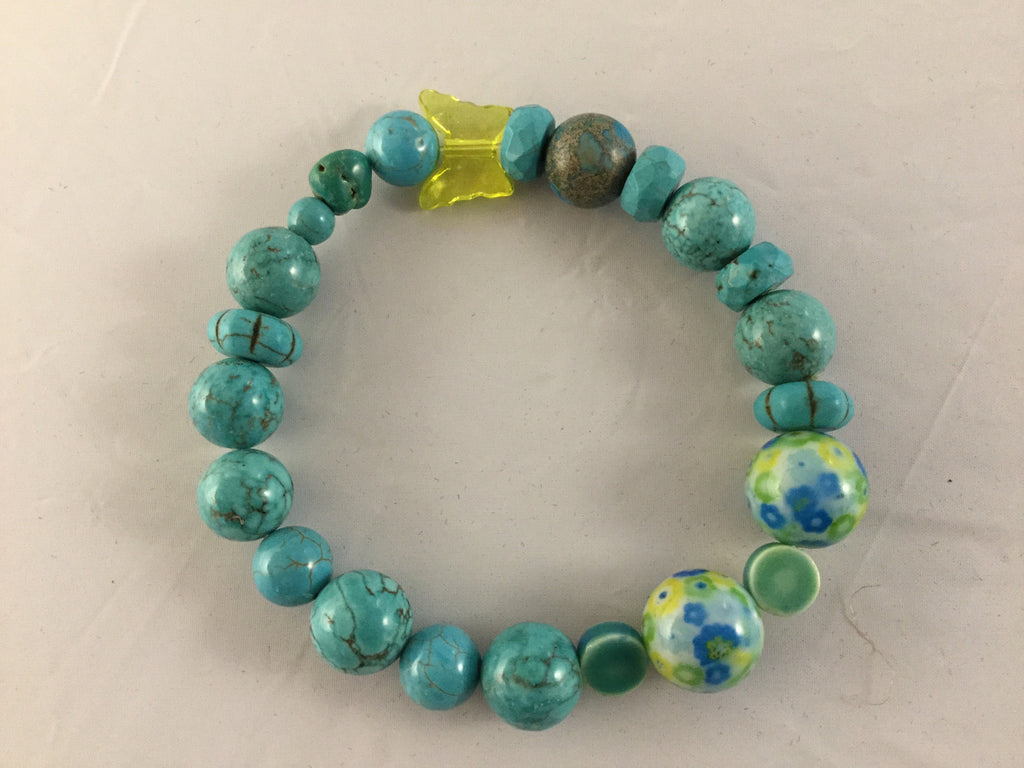 Real 10mm Turquoise balls with 2 yellow/turq ceramic 12mm beads  with floral turquoise/Howlite inserts. can be worn with BTY3S