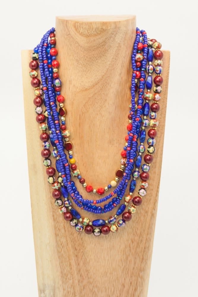 Beatrix & Bel - 4 Strand Blue, Rust, Solid and Floral Ceramic and Gold Necklace