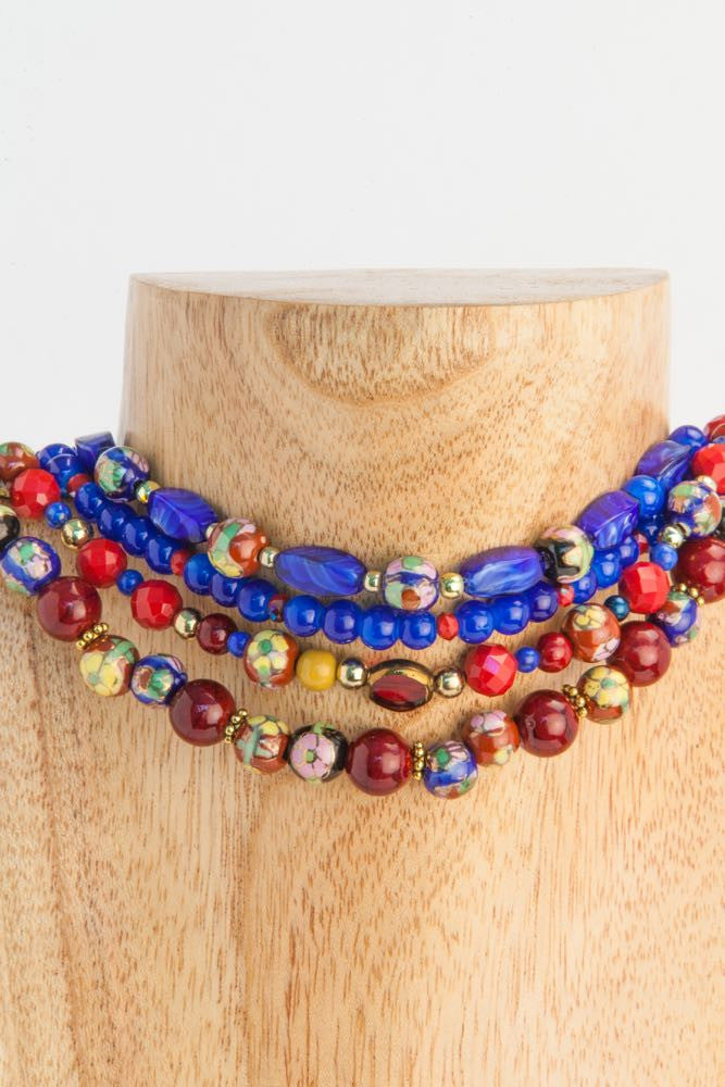 Beatrix - 4 Strand Blue, Rust, Solid and Floral Ceramic and Gold Necklace