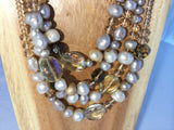 CHAMPAGNE: 4 strands of fresh 10mm app.water pearls and faceted taupe plastic.