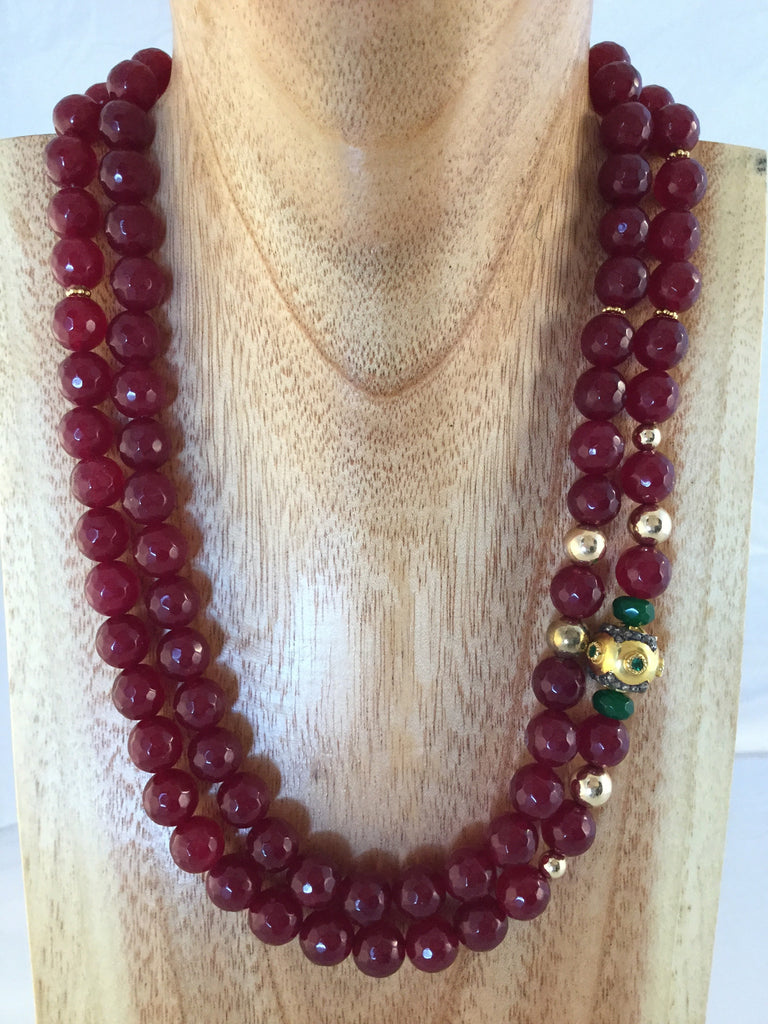 8mm faceted 2 string 8mm Rubies with gold inserts and emeralds.