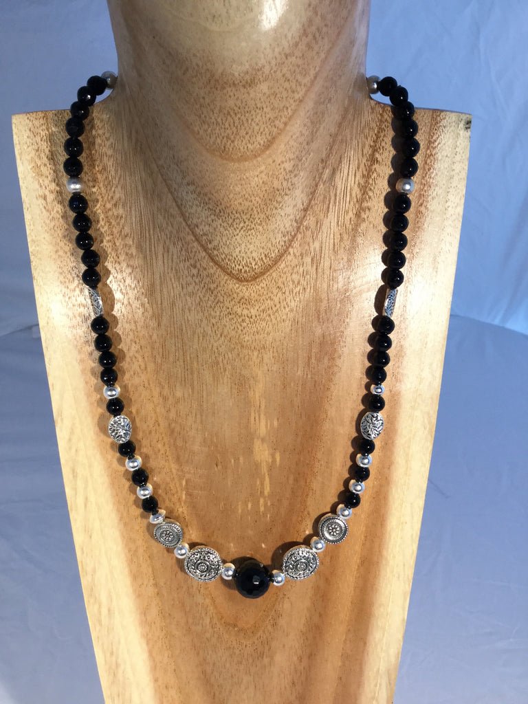 JET has 1 10mm faceted Onyx at the centre with sterling balls and silver plate inserts and toggle