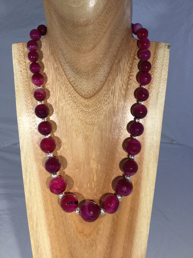 CLARET: large faceted fire Agate balls in descending size with Sterling inserts and clasp.
