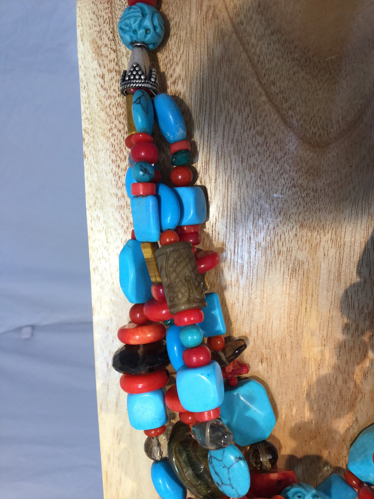 NAVAJO: has carved tiger's eye, smokey Quartz and carved Turquoise