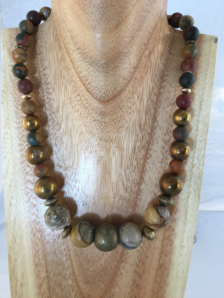 Niki mixes large Jasper with African metal and gold plated inserts.