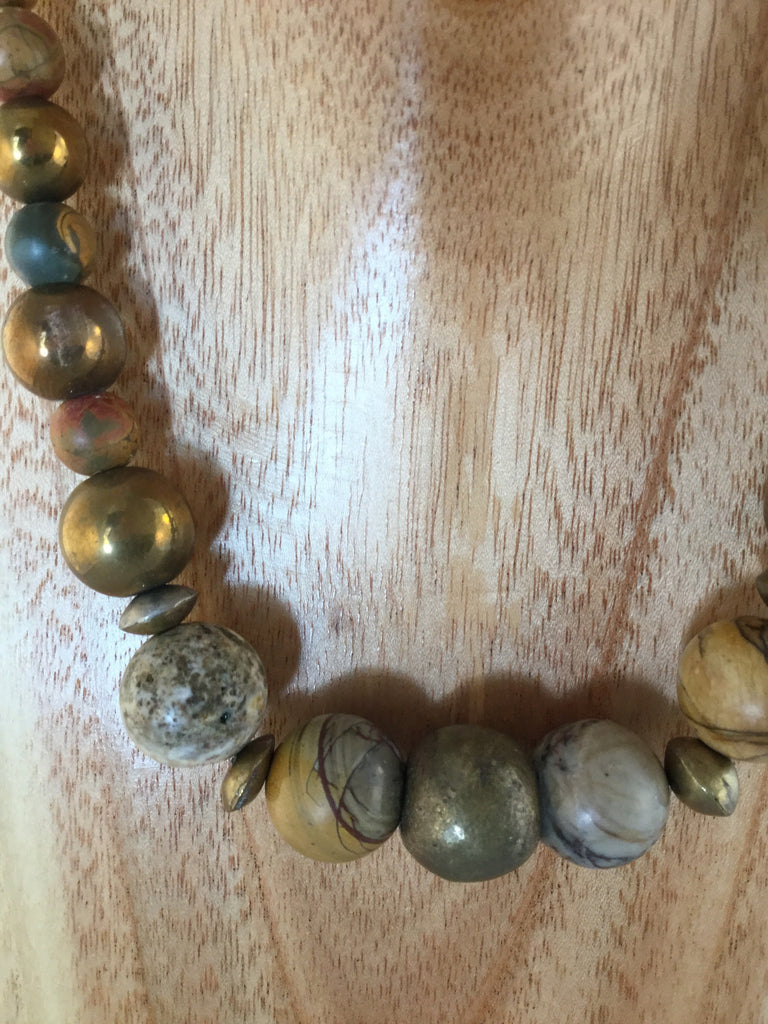 dark gold metal balls mixed with the Jasper and African metal.