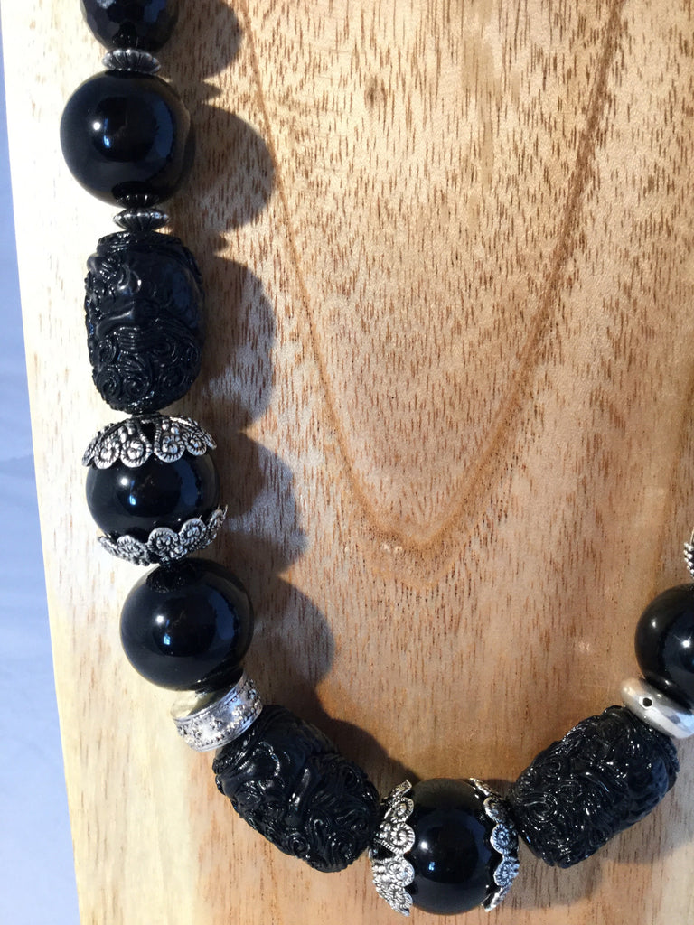 OBSIDIAN: 20mm Obsidian balls with carved Onyx nuggets.