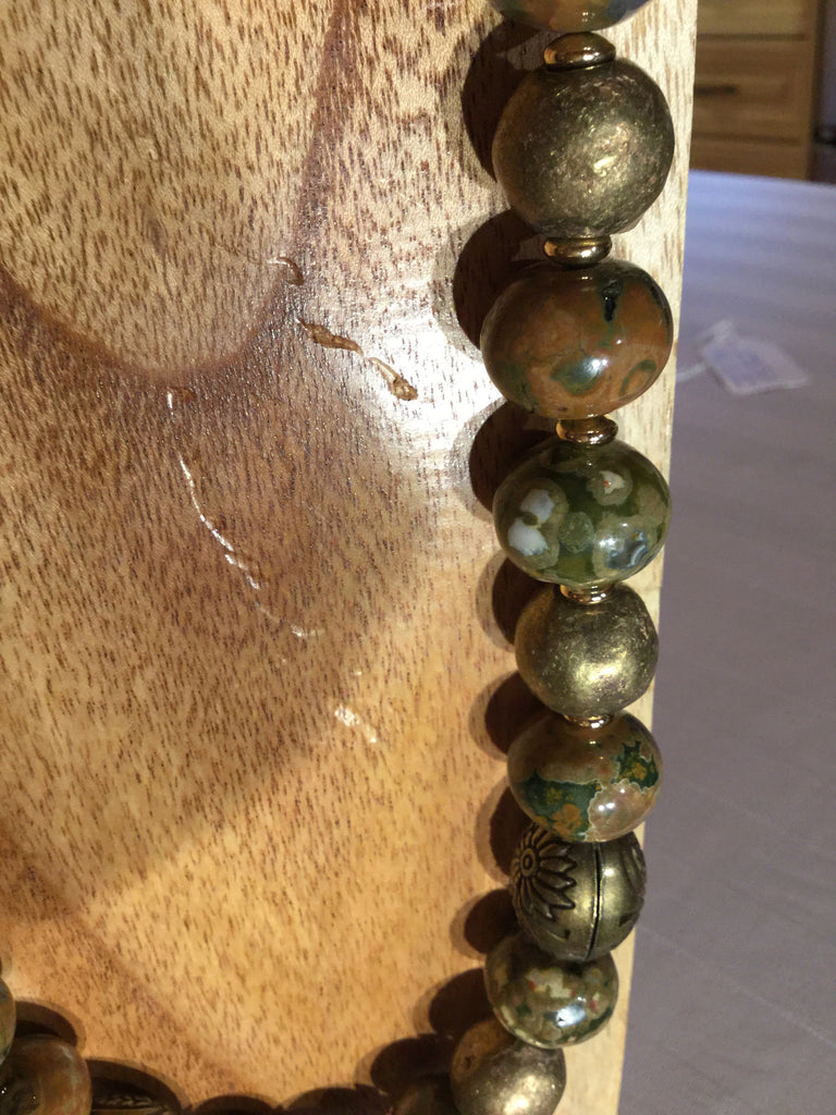 Rhyolite with African gold metal 15mm balls.