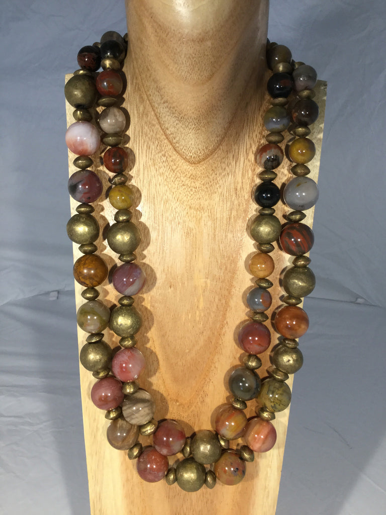 PETRA: 18 & 15mm balls of Petrified wood with African metal.