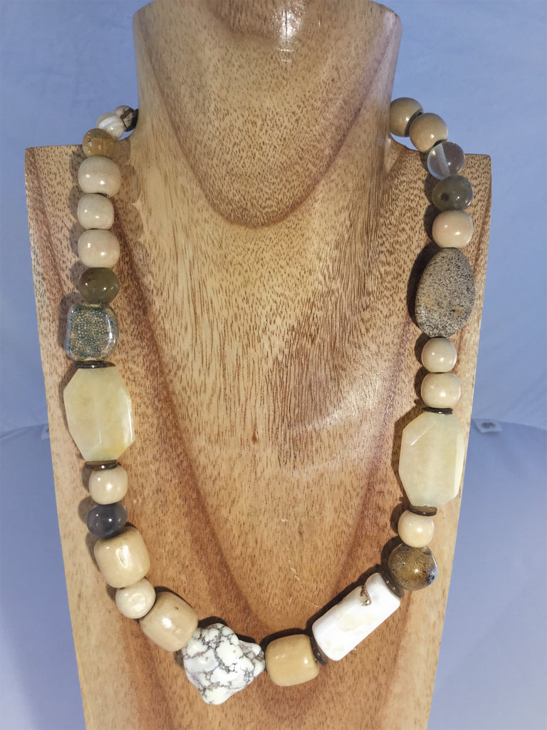 SANDI: blend of seashell, wood, ceramic and quartz