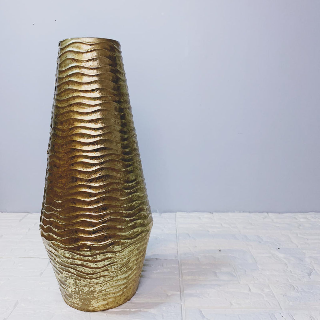 Gold vase with wavy pattern design