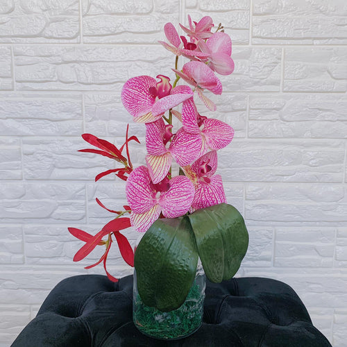 Pink Orchids in Ridged Vase
