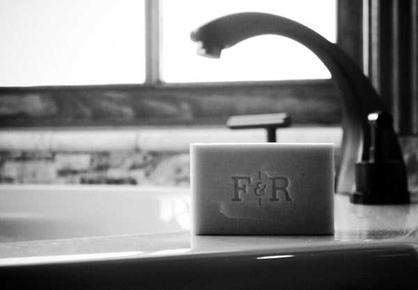 Image of Fulton & Roark bar of soap beside a sink