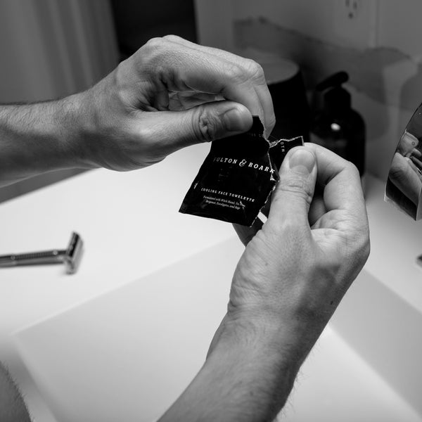Image of hands opening an after shave cloth