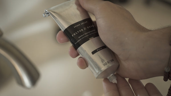 Image of hands holding Shave Cream
