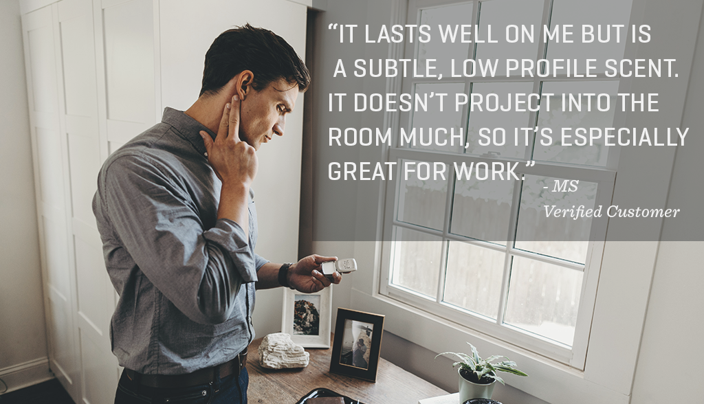"Image of guy applying solid cologne on his neck in front of a window with the quote: ""It lasts well on me but is a subtle, low profile scent. It doesn't project into the room much, so it's especially great for work."""