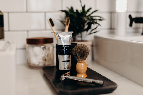 Image of Fulton & Roark Shave Cream, Shave Brush and Razor on a sink plate