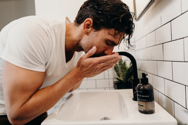 Image of a guy washing his face with Fulton & Roark Face Wash