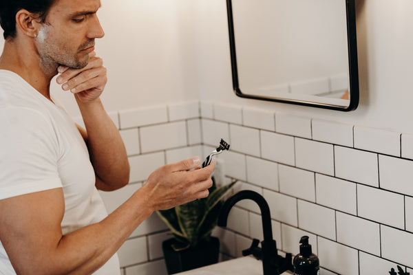 Image of man with shave cream on his face getting ready to shave