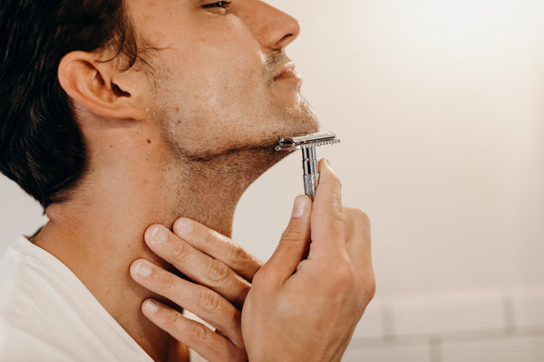 Image of a model shaving his face
