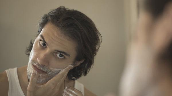 Image of a model washing his face with Fulton & Roark Face Wash