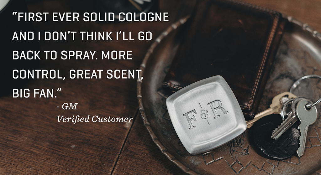 "Image of solid cologne on a table with the quote: ""First ever solid cologne and I don't think I'll go back to spray. More control, great scent, big fan."""