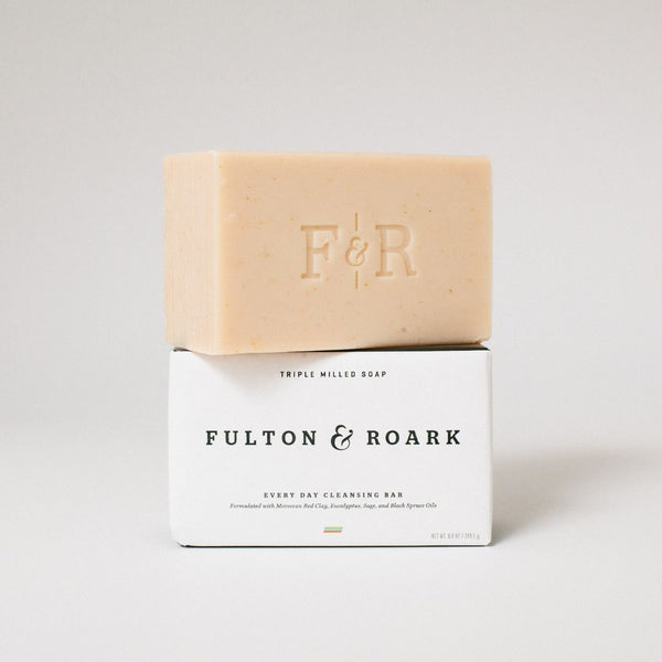 unwrapped bar soap on top of packaged bar soap