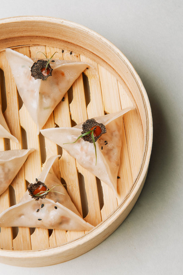 Steamed Plant Based Truffle Sriracha Dumplings