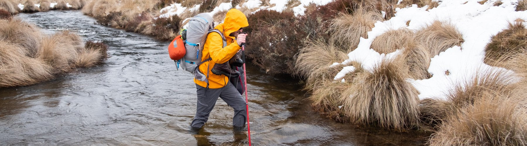 Kane braving a chilly crossing in kosciuszko NP.