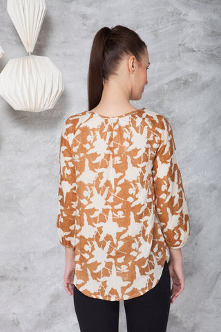 back view of a woman in a long sleeve peasant blouse in ahimsa silk with hand block print