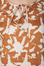 close up detail of a woman in a long sleeve peasant blouse in ahimsa silk with hand block print