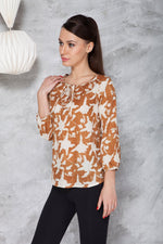 woman in a long sleeve peasant blouse in ahimsa silk with hand block print