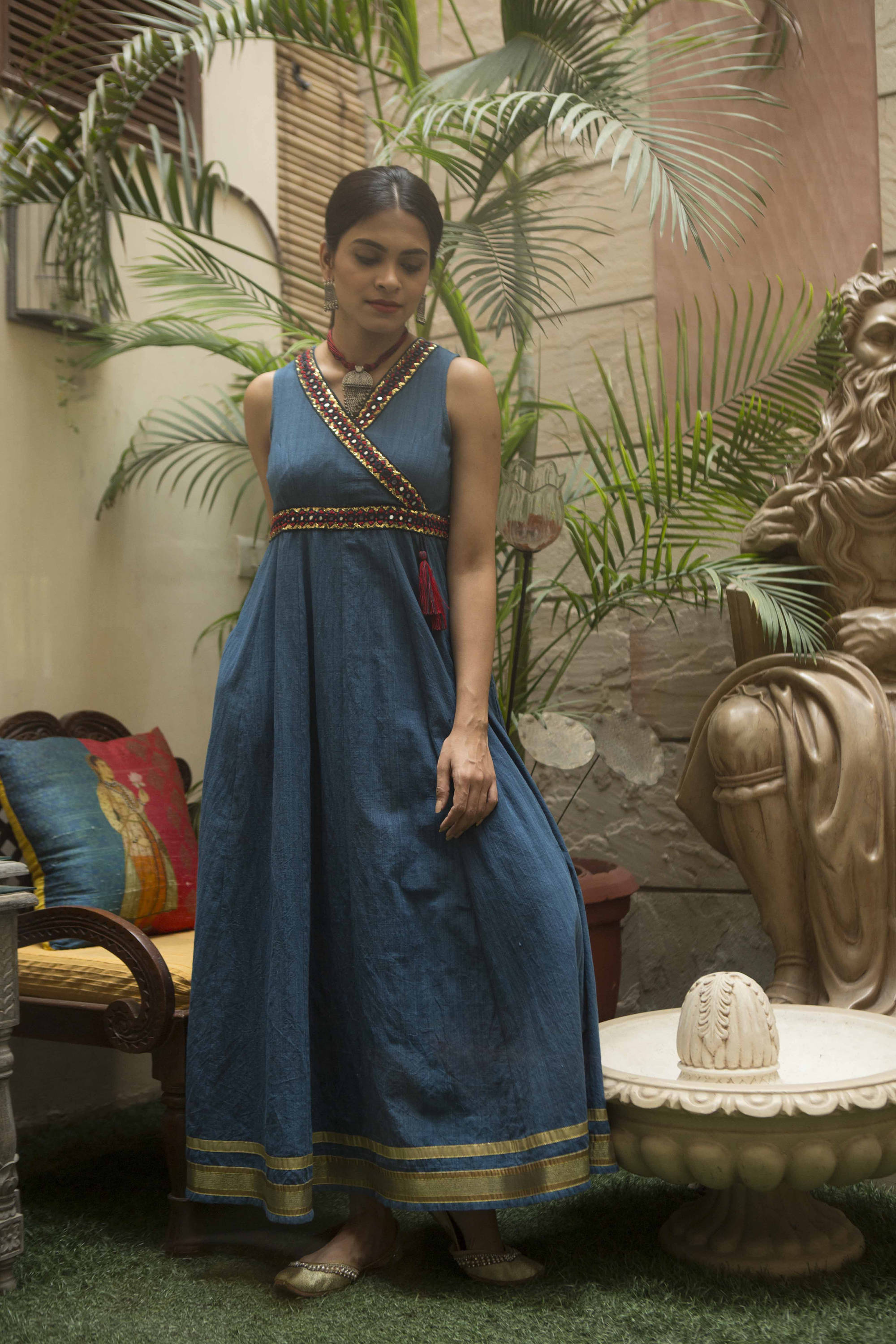 woman in a sleeveless indigo khadi maxi dress with mirror embroidery