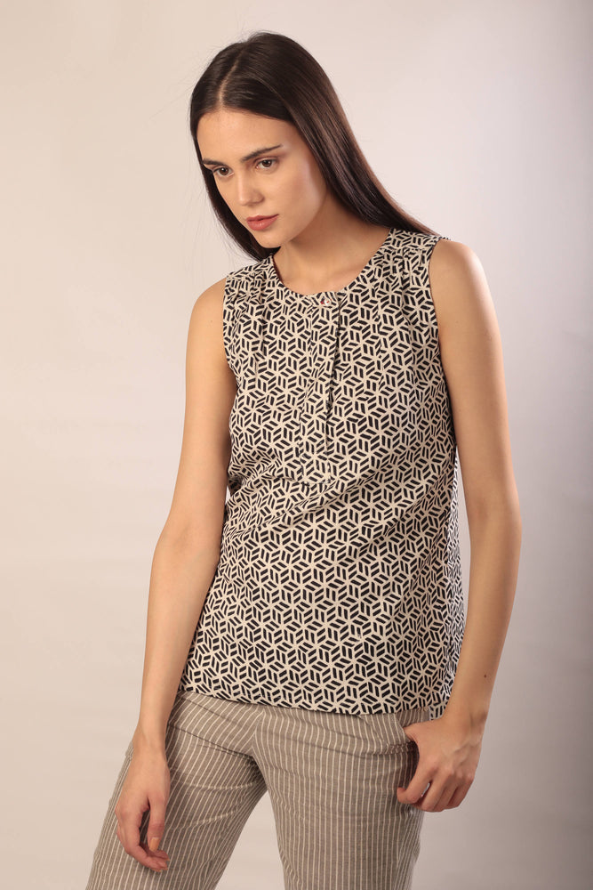 woman in a sleeveless henley top in ahimsa silk with hand block print