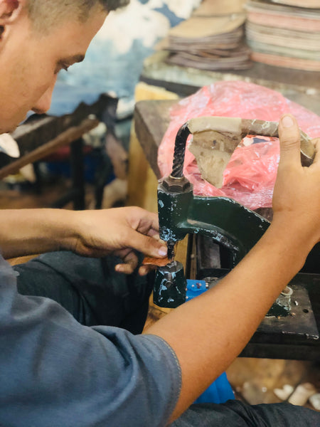 Artisan creating Lost Little One bags in Marrakesh