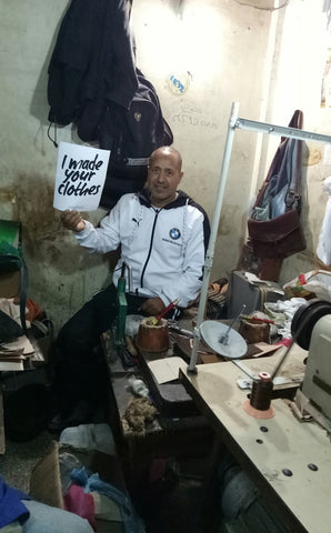 Moroccan leather artisan in his workshop where he produces ethically handmade Moroccan leather bags
