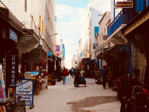 The main street in Essaouira Morocco, either side of the street littered with shops selling local artisanal products.