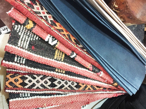 Vintage Moroccan carpet  strips ready to be used on our vegetable tanned moroccan leather bumbags. This picture is taken inside the workshop in Marrakech, Morocco