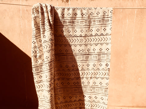 A mud cloth blanket hangs on the clothes line of a terrace in Essaouira Morocco