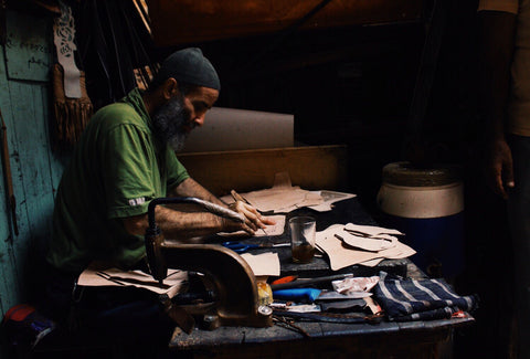 inside the workshop of a leather artisan in Morocco